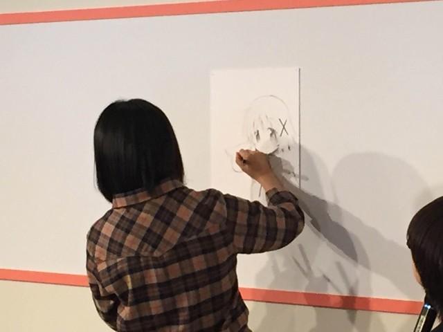 ↑描いているのは「ひだまりスケッチ」主人公ゆのと、「魔法少女まどか☆マギカ」のマスコット的存在のキュゥべえ。特にゆのは先生自身を投影したところもあり、思い入れの強いキャラクター、とのこと