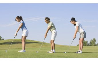 Three women playing golf