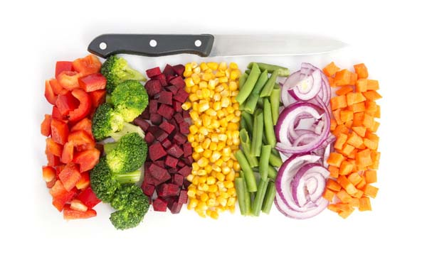 37558895 - cut colorful vegetables in line with knife on white background