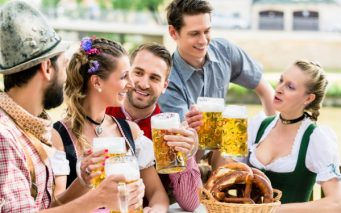 45443075 - friends in bavarian beer garden drinking in summer