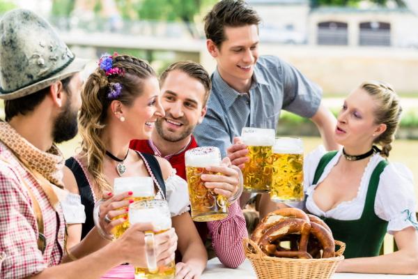45443075 - friends in bavarian beer garden drinking in summer