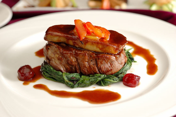 47007490 - tournedos rossini. steak with foie gras. french steak dish with foie gras and croutons.