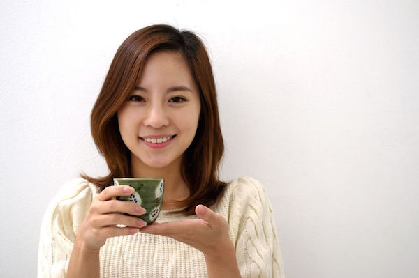 17347743 - happy woman drinking tea