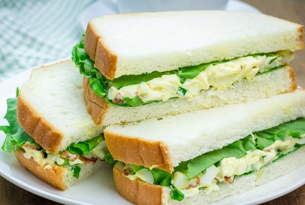 44263280 - sandwich with egg salad, bacon, green onion and lettuce