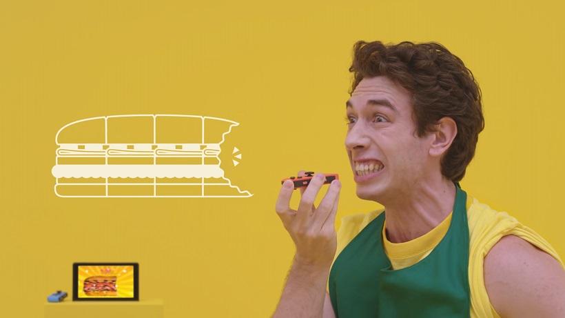 ↑モーションIRカメラが口の動きを感知し、サンドイッチの食べた量を競う「大食いコンテスト」
