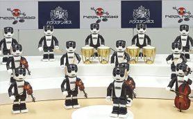 「変なホテル」のハウステンボスがロボット事業を本格始動! ロボホン21体による「ハピロボ楽団21」も披露【動画】