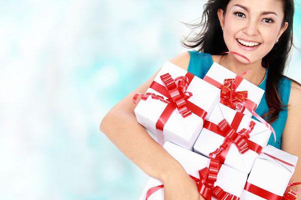 16800481 - happy woman holding present in her hand