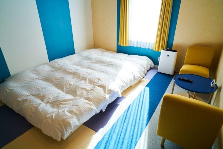 ↑ロータイプのベッドにすることで、広々と空間を使える「ファミリー和室」