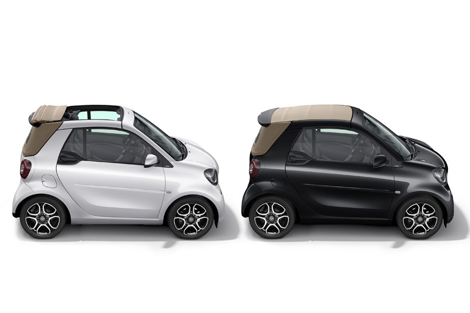 beauty shot: smart fortwo cabrio, 2/3 rear, top view bodypanels: white (uni) tridion: cool silver (metallic) roof top: black rims: R91 people shot: slice-of-life cast (agency): Sian A. (Muse) copyright: full buyout cast (agency): Jorge R. (4play) copyright: full buyout copyright: full buyout