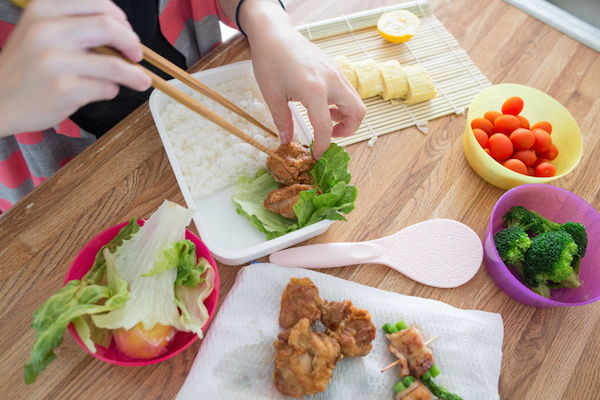 54614407 - making bento, japanese style lunch box