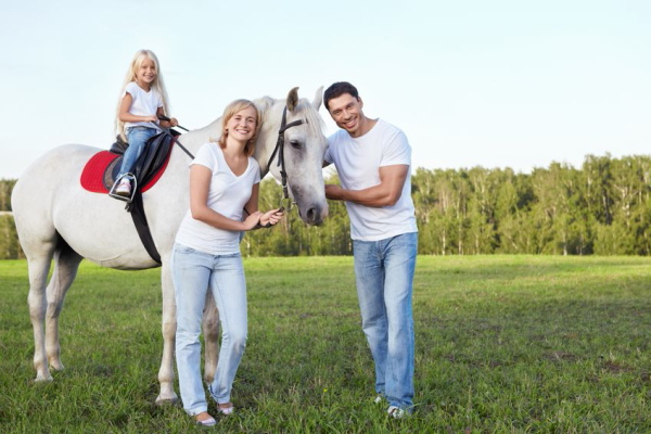 11699027 - family with a child on a horse
