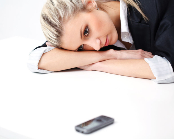 39124588 - closeup portrait of business woman waiting for call over white background