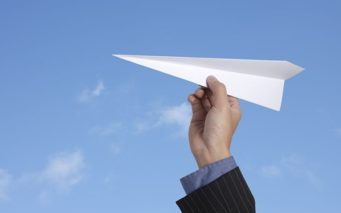 10563638 - business man throwing a paper plane