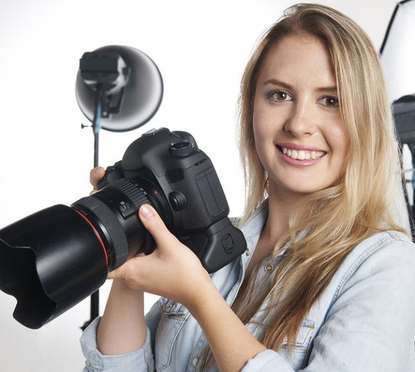 47560822 - female professional photographer working in studio