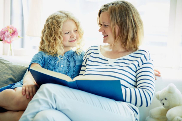 21174339 - portrait of cute girl and her mother reading a book at home