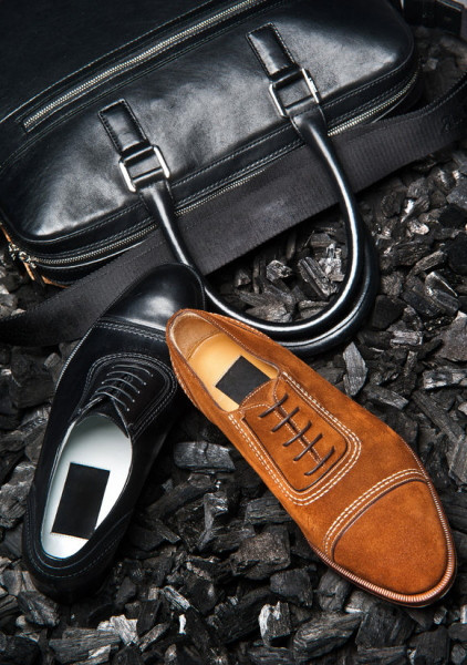 29879802 - close-up view of the shoes of a businessman and his business bag