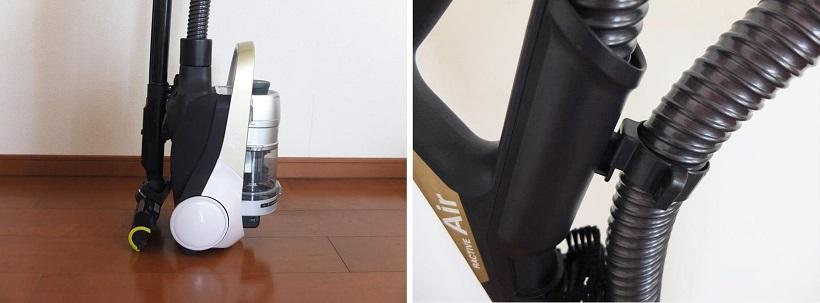 ↑延長パイプの先端裏面にフックがあり、本体を起き上がらせてから裏面のホルダーにフックを挿し込むと(左)、自立して収納できます。また、ホースフックをハンドル裏側にあるホルダーに挿し込めば(右)、ホースをすっきり収納可能