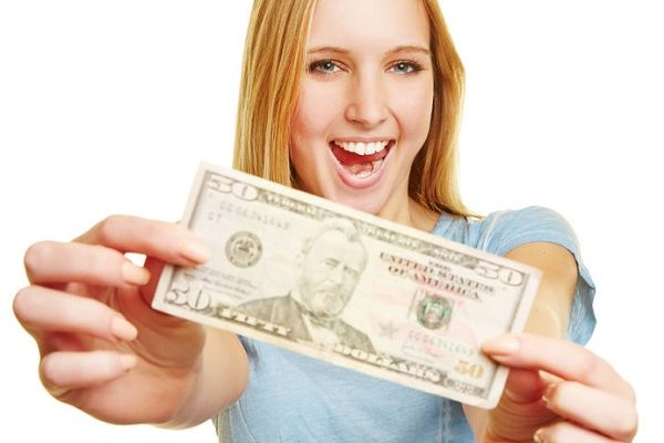 38857197 - happy young woman showing 50 dollar bill in her hands