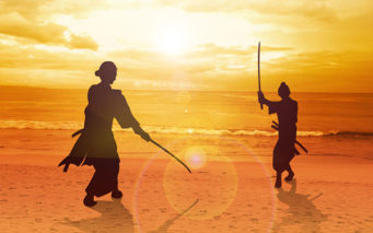 56171065 - two samurai in duel stance facing each other on the beach