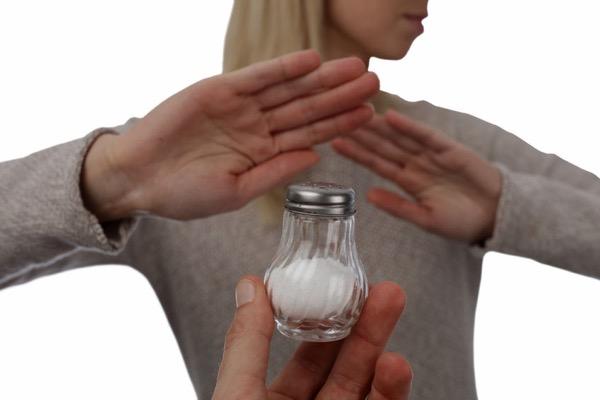 77178469 - woman refusing salt. health care concept, hypertension prevention