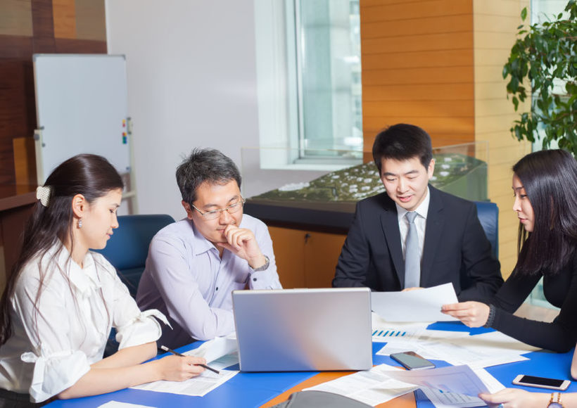 63849576 - business meeting, asian people sitting for a table with business plan on high floor in the office. asian nationality a woman shows a business graph of his business partner.