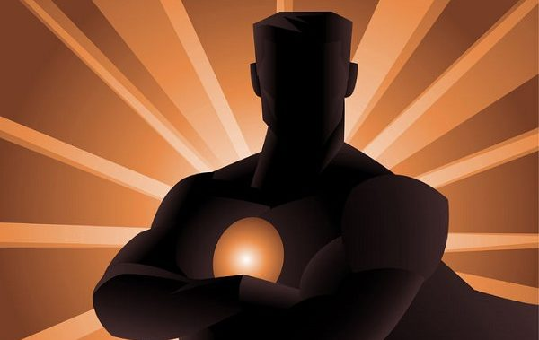 34230174 - superhero shadow front view, with crossed arms and shining powers behind him. vector illustration.