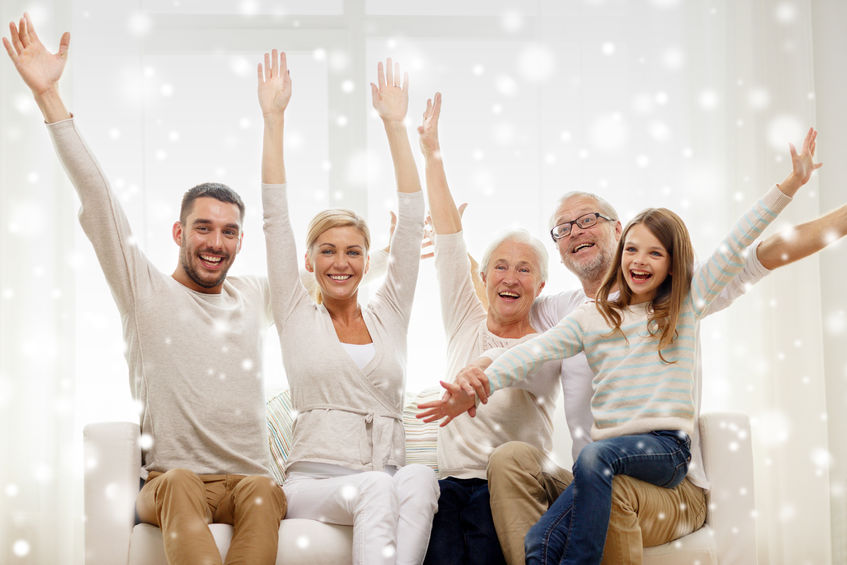 34412638 - family, happiness, generation and people concept - happy family sitting on sofa and rising hands at home