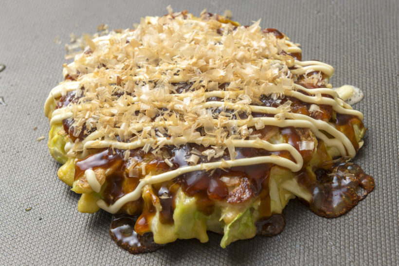67885387 - okonomiyaki, a japanese savoury pancake containing a variety ingredients