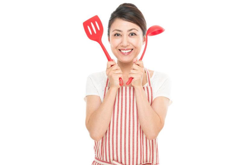 72112890 - asian woman wearing an apron