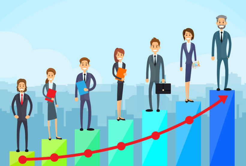 42468728 - business people standing on financial bar graph