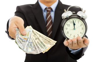 30531305 - businessman holding money and clock