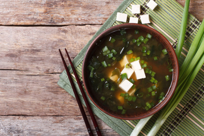 35951505 - japanese miso soup in a brown bowl on the table. horizontal view from above