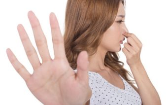 48847991 - portrait of a young woman holding her nose because of a bad smell.