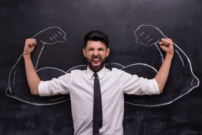 36992991 - funny picture of young businessman ready to win on chalkboard background. two strong muscular arms painted on chalkboard