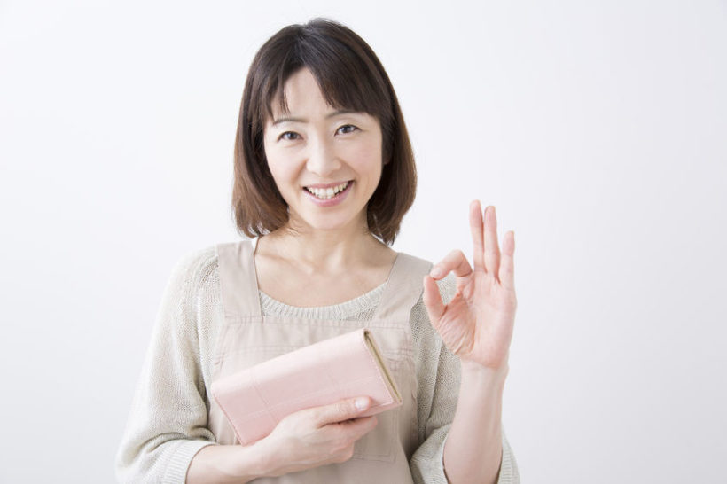 43754733 - housewife smile with a purse