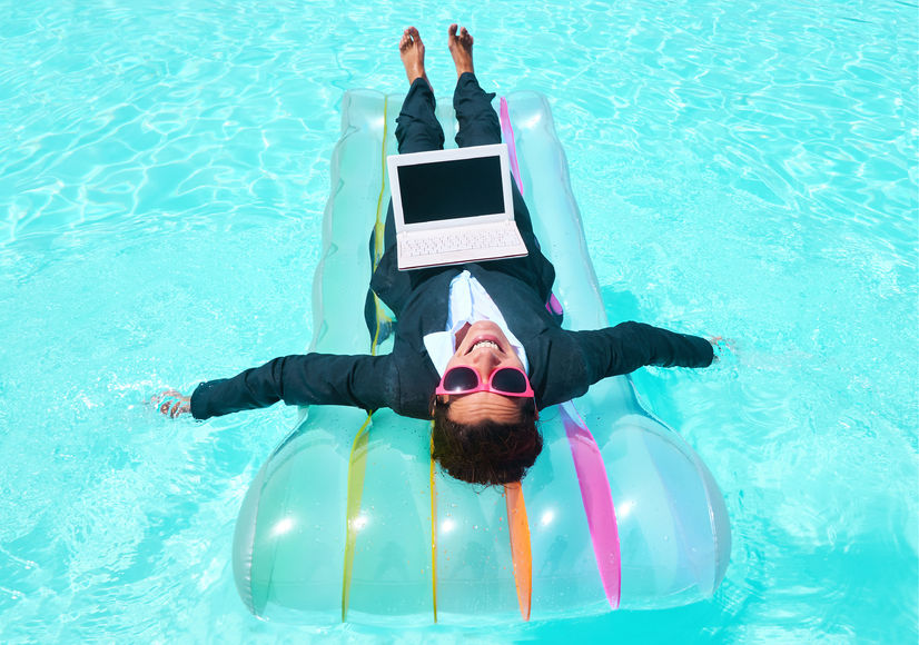 73044420 - happy businesswoman swimming on lilo in pool