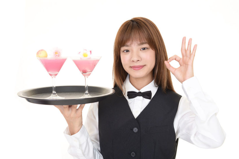 92524967 - young waitress serving a cocktail