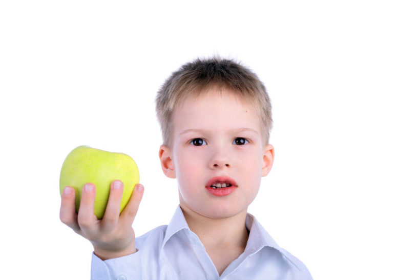 95454048 - handsome little child with the green apple